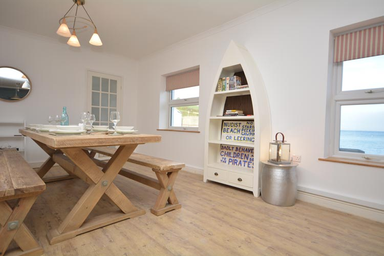The dining area in Sandy Cove dog friendly cottage in Portmellon in Cornwall