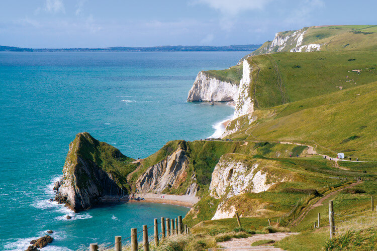 Lulworth Cove white chalk cliffs on the Dorset coast