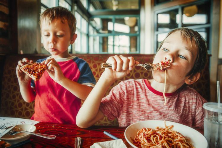 kids eating at pasta restaurant