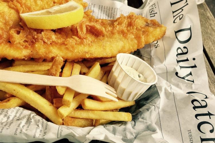 Fish and chips wrapped in newspaper