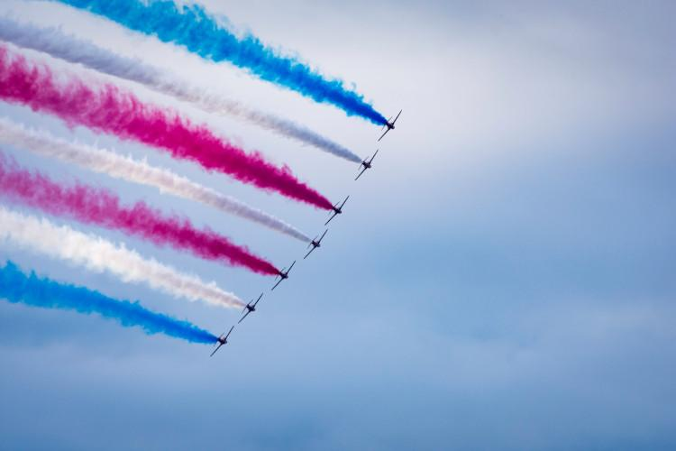 jets flying with colours in sky at airshow
