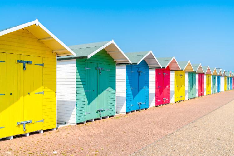 Colourful beach huts on Eastbourne beach