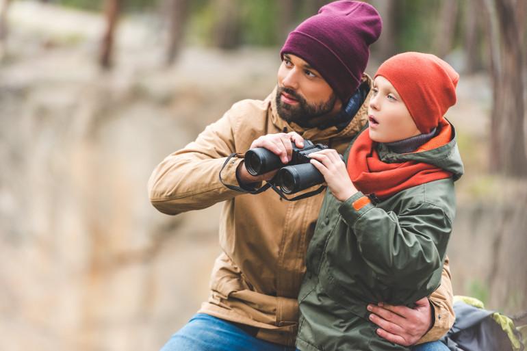 man and child binoculars