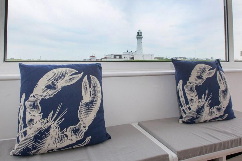 Lobster cushions in front of window