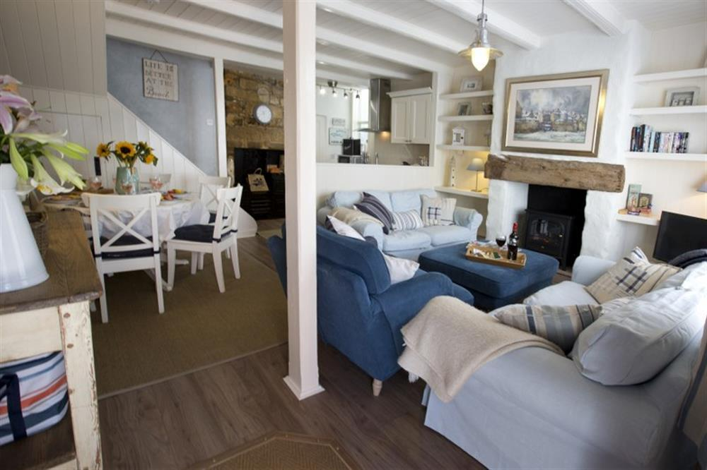 The living room at Lilly's Cottage in Robin Hoods Bay combines coastal blues and whites