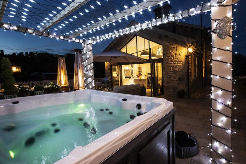 The hot tub will be ready and waiting for guests at this luxury holiday cottage