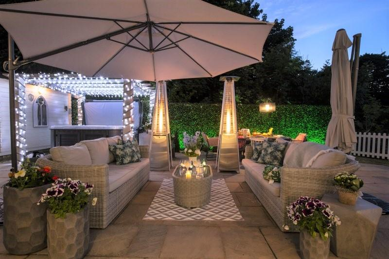 Enjoy alfresco dining and a dip in the hot tub at this outdoor seating area