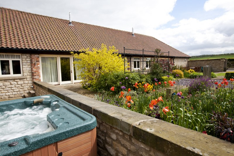 The hot tub at Stables and The Hay Barn - North York Moors