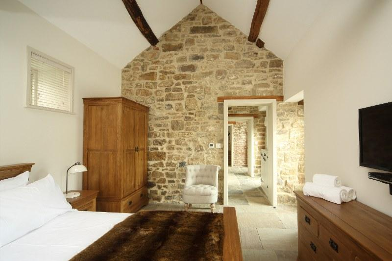 Exposed brick work adds to the character of a barn conversion