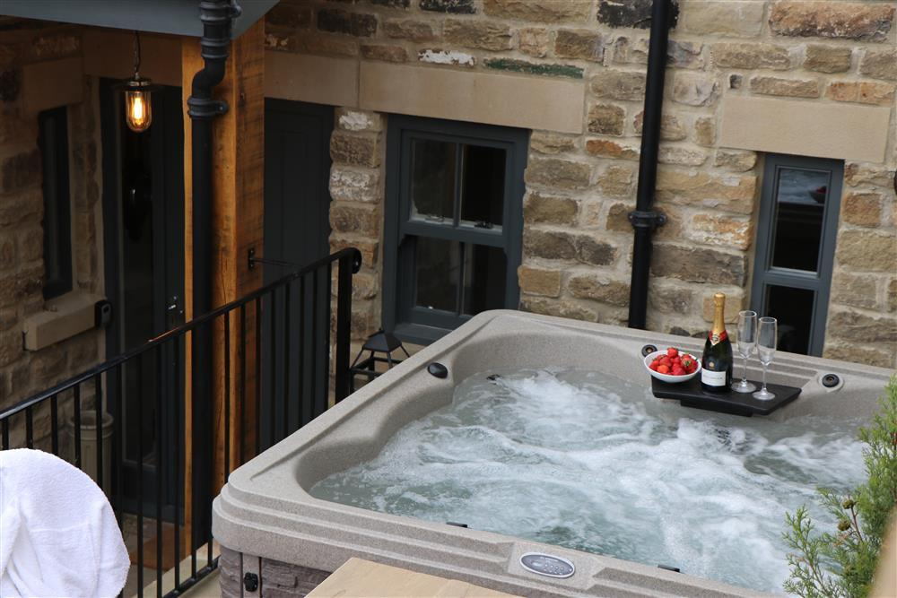 Relax with a glass of bubbly in the hot tub.