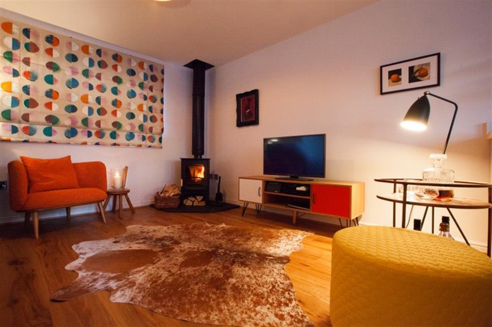 At night the lounge is super cosy with the soft crackle of the wood-burner and the glow from the lamps.