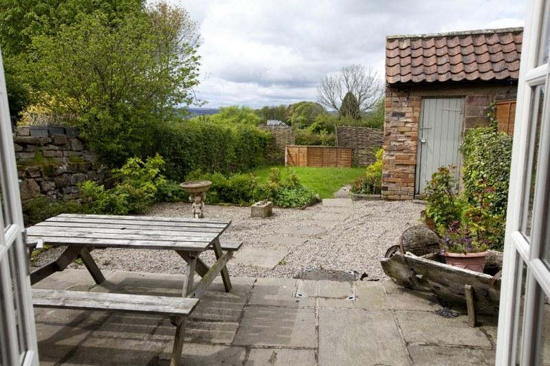 The pretty west-facing garden in Egton Cottage. The perfect place to enjoy lunch al fresco or soak up some summer sun.