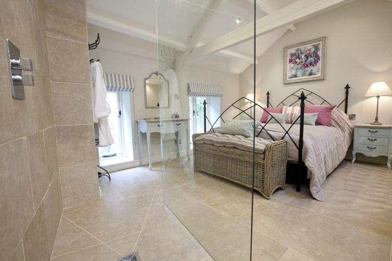 Discover the breath-taking master bedroom with it's dramatic walk in shower.
