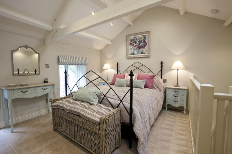 A room for romantics, this stunning bedroom boasts a super-king size bed and the finest White Company bed linen.