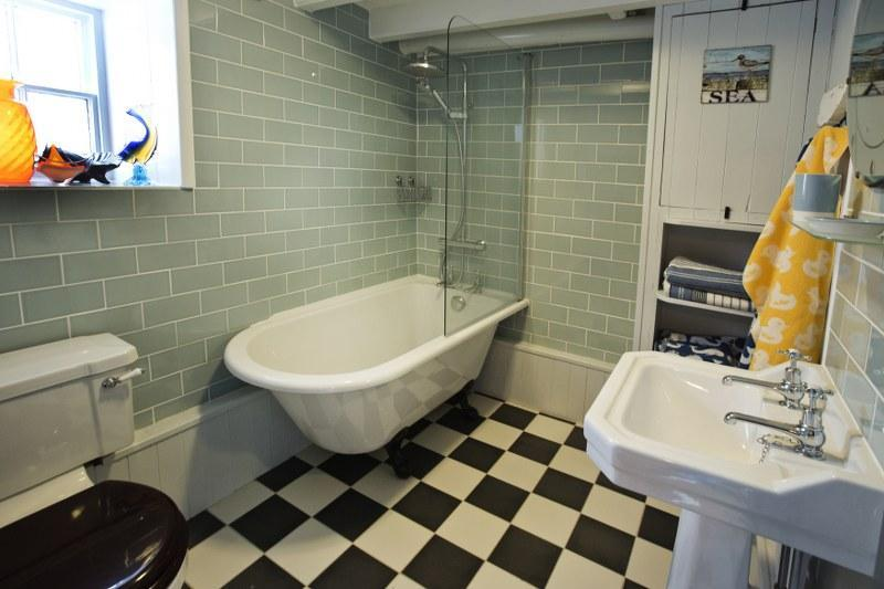 The lovely house bathroom with its claw foot free-standing bath.