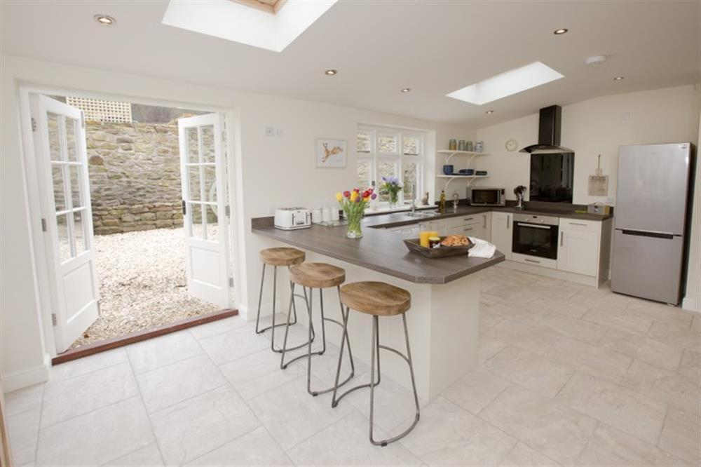 Discover the wow factor open plan kitchen.