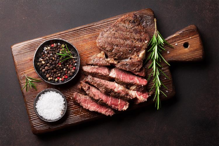 Fresh beef steak on a chopping board