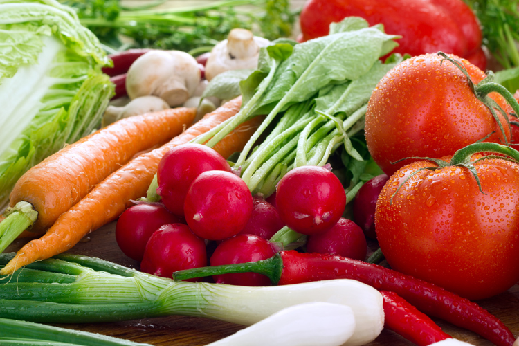 Fresh vegetables - carrots, radishes, tomatoes and leeks