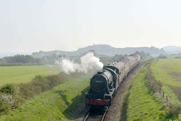 Steam Train of the North Norfolk Railway travelling through the countryside