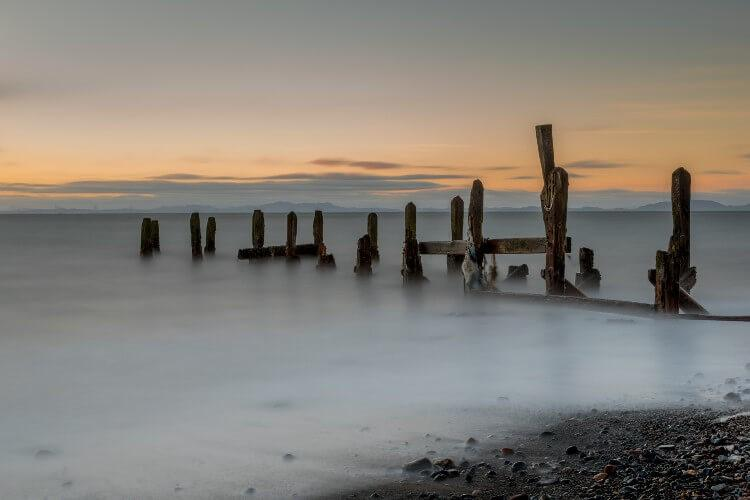 Long Exposure as the tide laps the old pier at Maryport, Cumbria