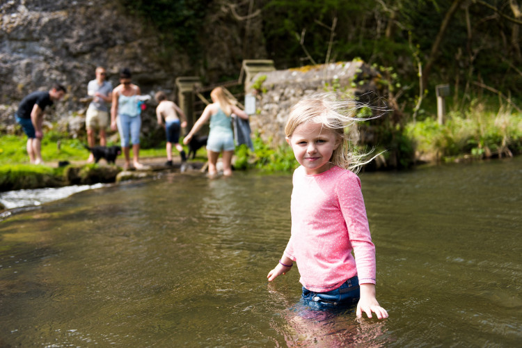 child crossing stepping stones Dovedale