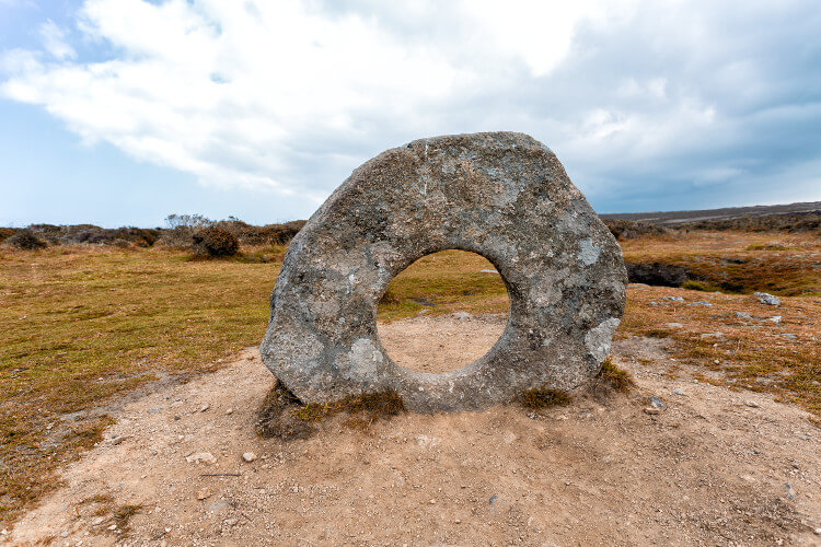 Squeeze through the Men-an-Tol stone