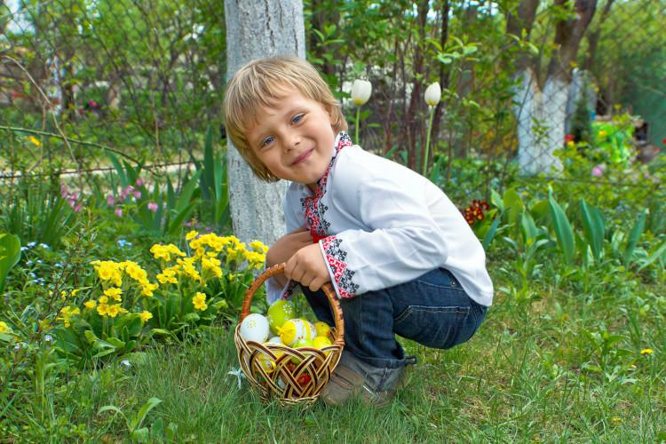 boy collecting easter eggs