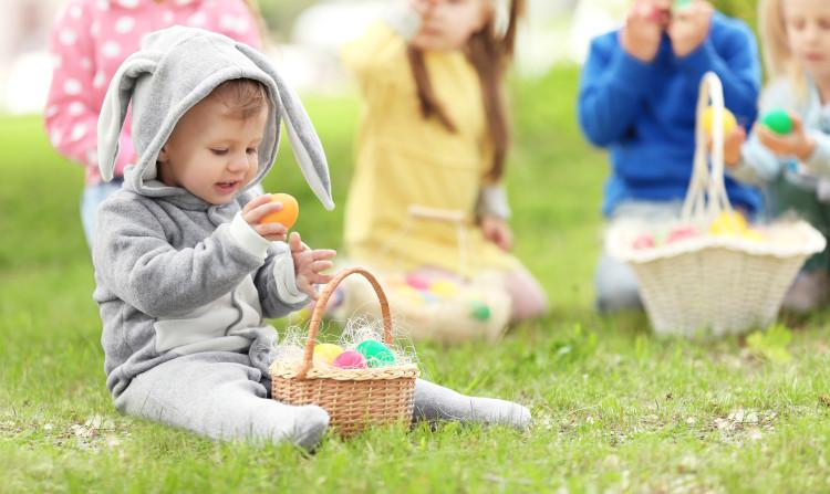 children and eggs on grass