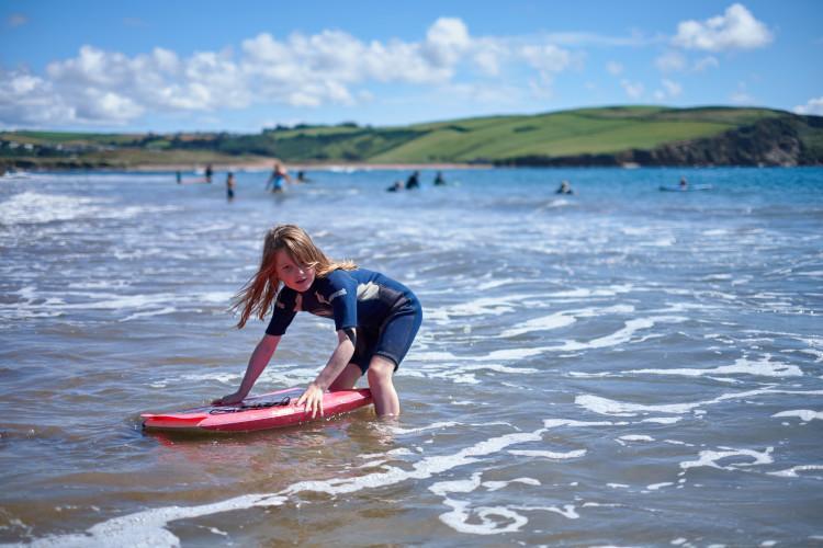 girl surfing in South Devon