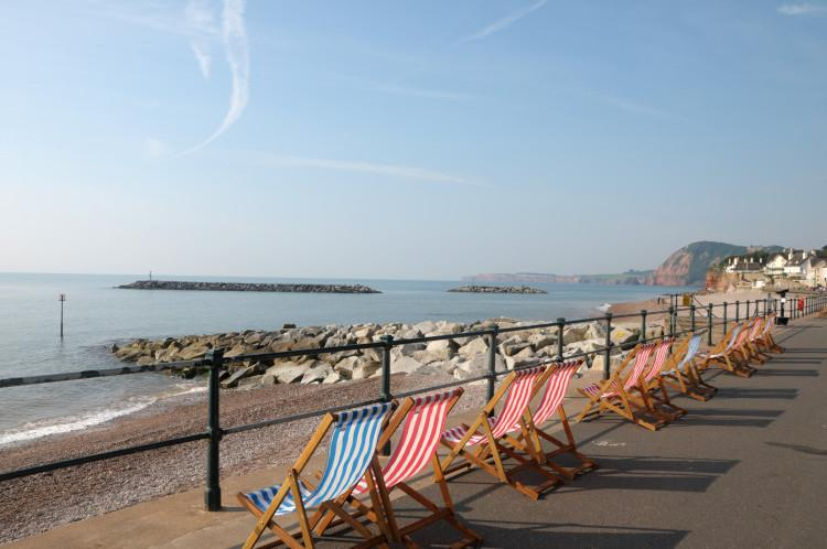 Sidmouth deckchairs on promenade South Devon