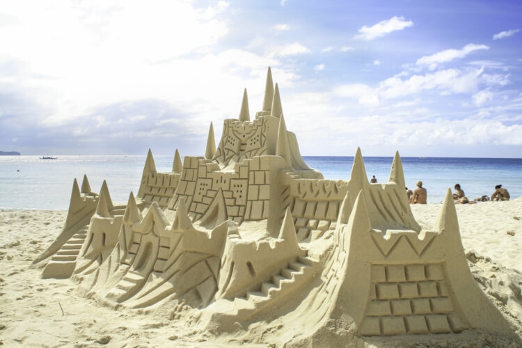 a giant sand castle on a beach in Wales