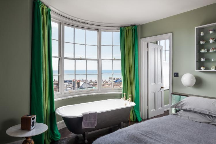 Roll-top bath with sea views