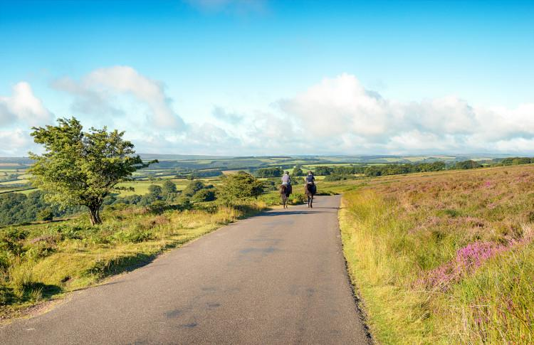people riding horse on Exmoor