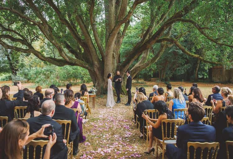 Couple getting married under the oak trees