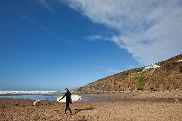 Surfer takes to the waves on Saunton Sands