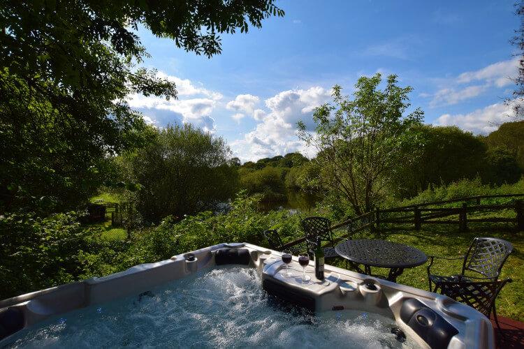 Enjoy nice views from the hot tub at Heron Lake Barn, Devon